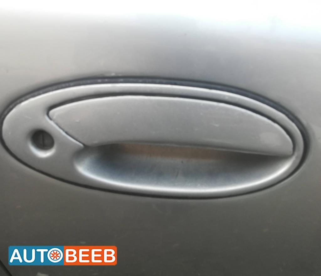 Body  Door Handle  Mitsubishi Lancer